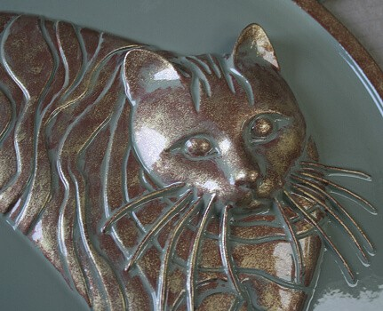 Decorative cat wall plaque sculptured in raised relief