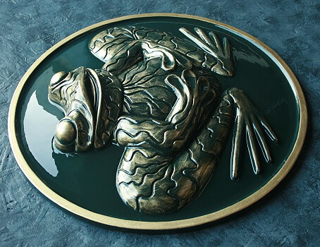 Green and gold frog wall plaque sculptured in raised relief
