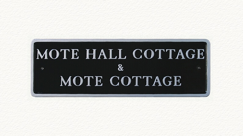 Black rectangular house sign