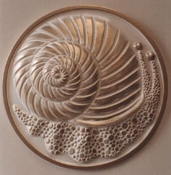 Snail wall plaque sculptured in raised relief with gold decoration