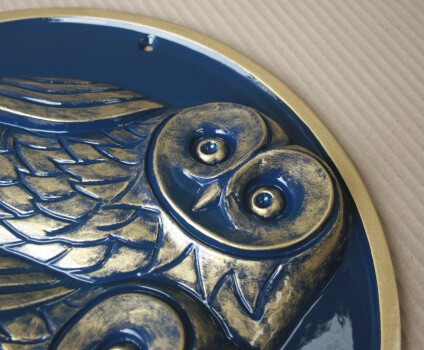Owl wall plaque sculptured in raised relief with blue & gold colours