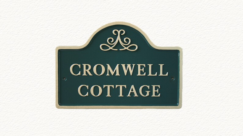 Bridge shaped house sign in green and gold