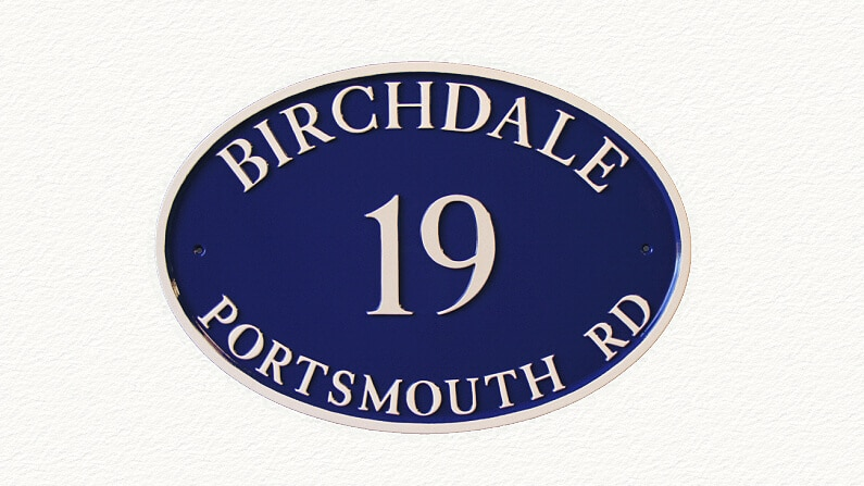 Oval metal house sign in blue and magnolia