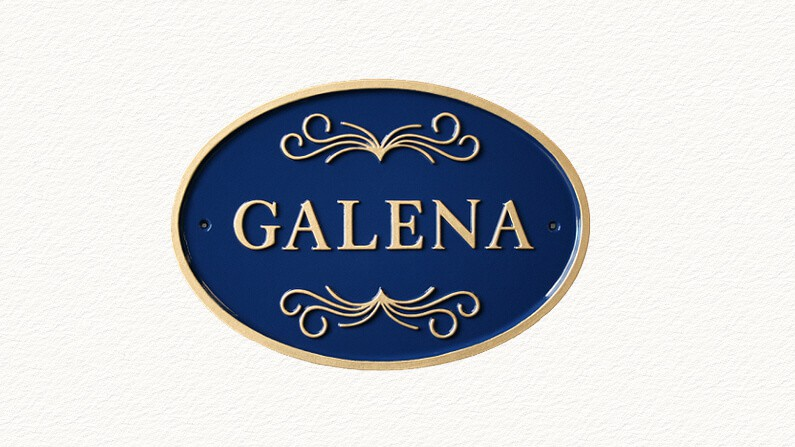 Metal cast alloy house sign in blue and gold
