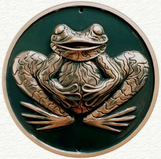 Wall plaque of stylized sculptured frog