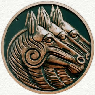 Circular sculptured plaque of horses heads