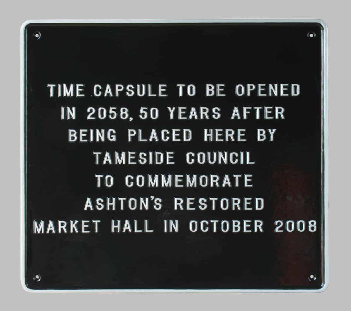 Large black and silver commemorative wall plaque