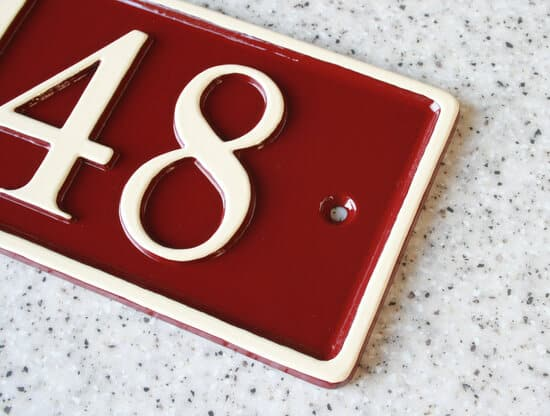Rectangular shape number house sign in maroon and magnolia