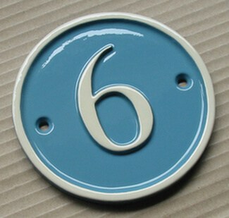 Small round home number sign in light blue