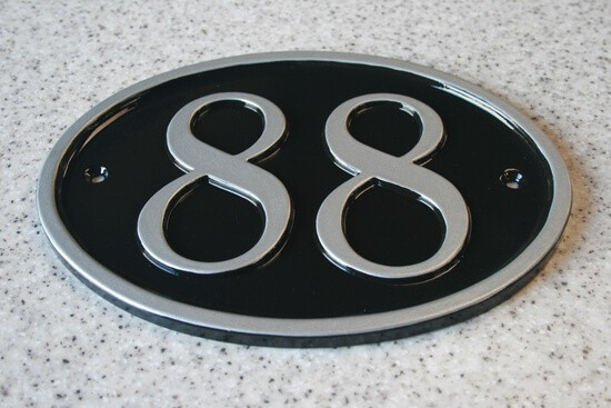 Oval sign with large address numbers