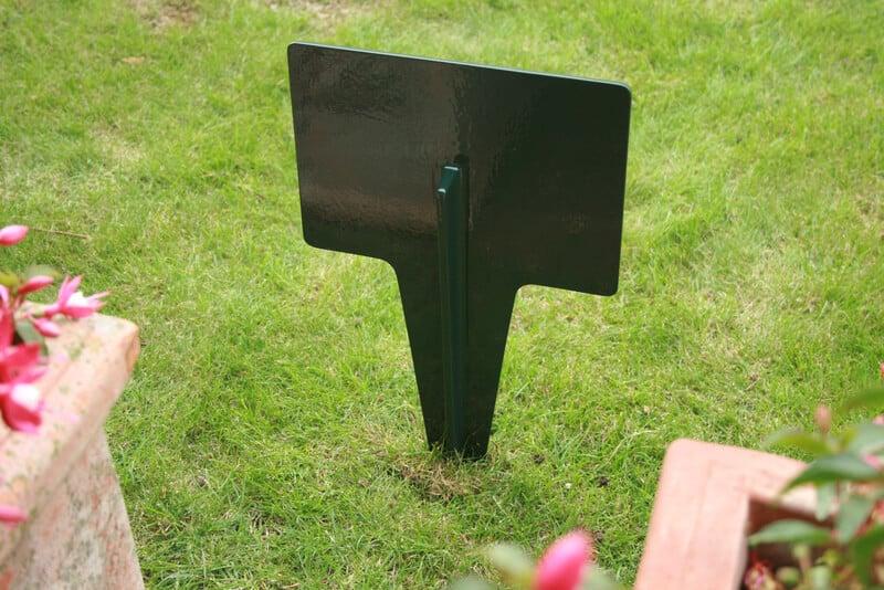 Rectangular metal lawn sign in dark green