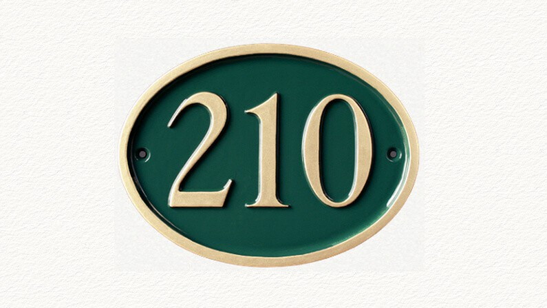 Traditional house number sign in green and gold