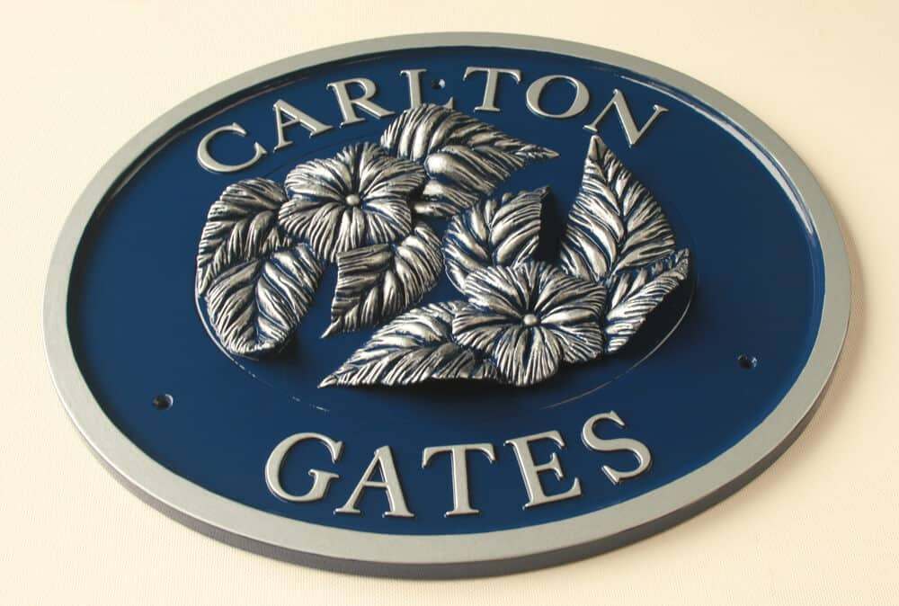 Large decorative oval house sign in blue and silver