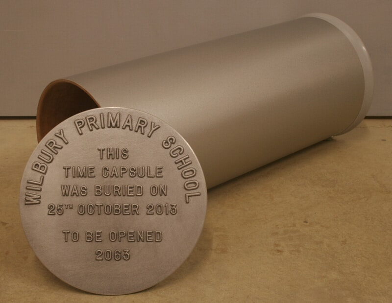 School time capsule with custom text cast in the centre