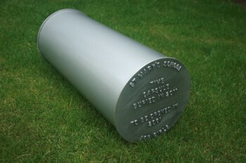 Large composite time capsule with text cast on lid
