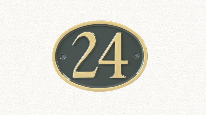 Small oval cast metal house numbers