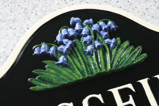 Cast metal sign with bluebell flowers