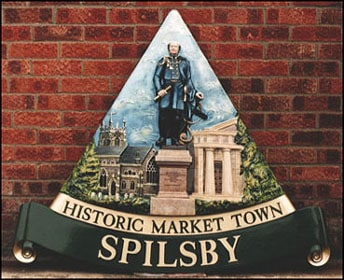 Spilsby village sign with sir john franklin, the old court house and church