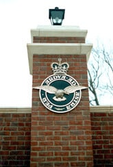 Cast metal crest mounted on pillar at RAF Cranwell