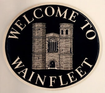 Wainfleet town sign with the historic magdalen school