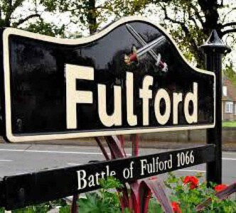 Fulford village york sign with flower beds