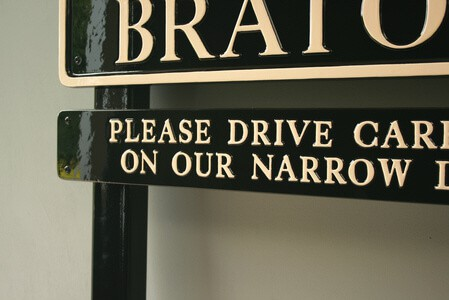Bratoft village sign finished in black and magnolia