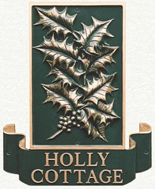Metal house sign of holly leaves