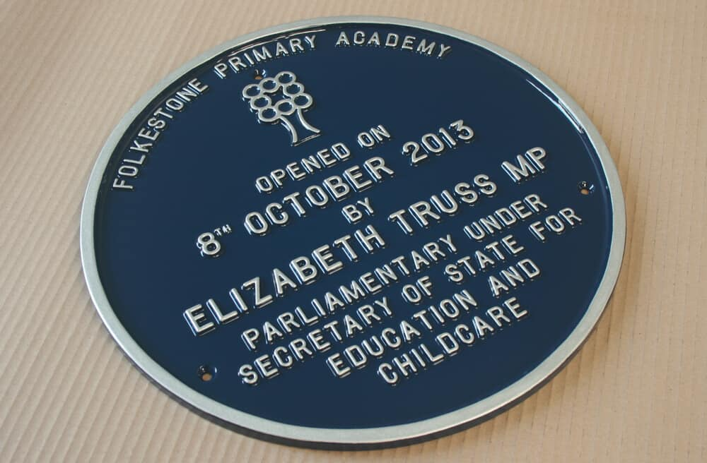 Round cast metal blue plaque