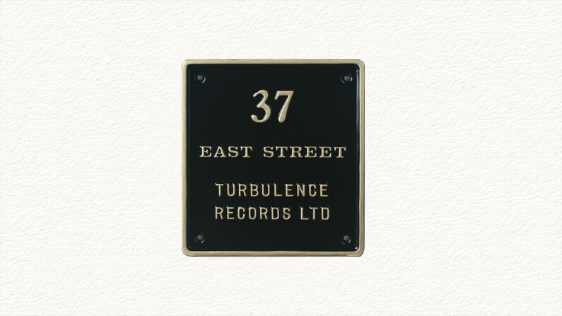 Rectangular house sign in black and gold