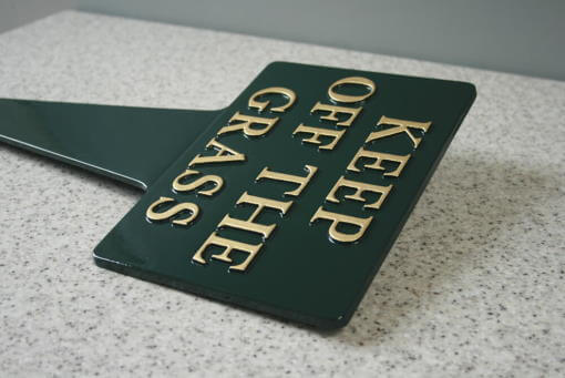 Stylized sculptured wall plaque cast in metal