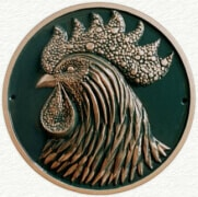 A range of sculptured animal wall plaques